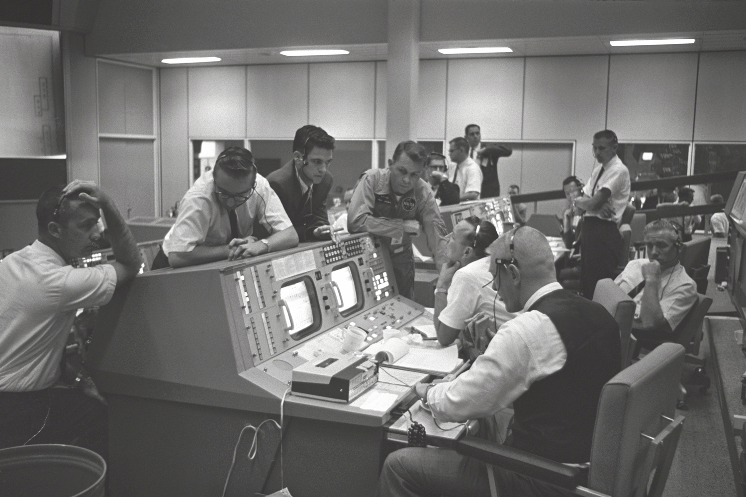 View of the Flight Directors console in the Mission Control Center ...